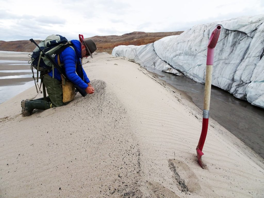 Kurt Kjær collecting sediment samples from the crater's dranage system. Credit: Natural History Museum Denmark.
