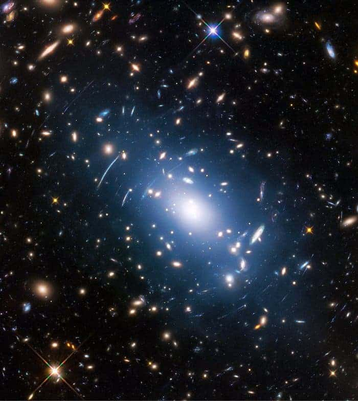 Abell S1063, a galaxy cluster, was observed by the NASA/ESA Hubble Space Telescope as part of the Frontier Fields programme. The huge mass of the cluster — containing both baryonic matter and dark matter — acts as cosmic magnification glass and deforms objects behind it. In the past astronomers used this gravitational lensing effect to calculate the distribution of dark matter in galaxy clusters. Credit: NASA, ESA, and M. Montes (University of New South Wales, Sydney, Australia).