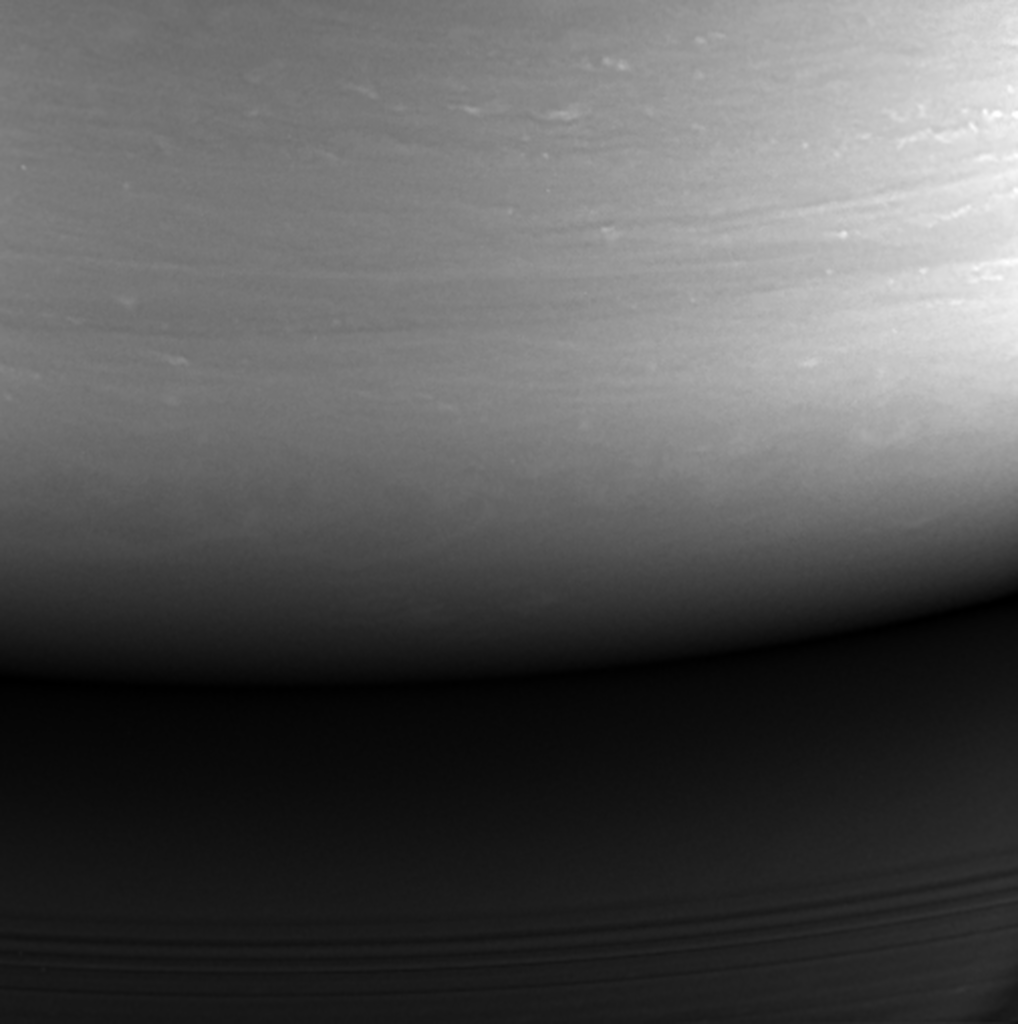 This monochrome view is the last image taken by the imaging cameras on NASA's Cassini spacecraft. It looks toward the planet's night side, lit by reflected light from the rings, and shows the location at which the spacecraft would enter the planet's atmosphere hours later. Credit: NASA/JPL-Caltech/Space Science Institute.