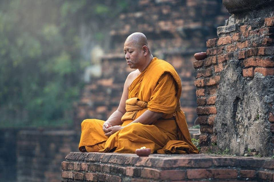 Buddhist monk meditating.