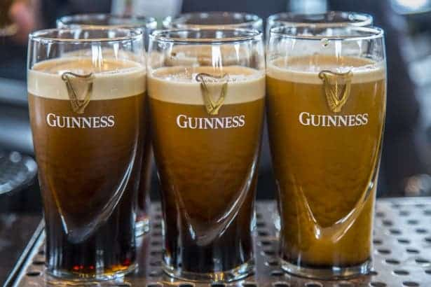 Why the bubbles from guinness go down not up - Guinness beer images ...