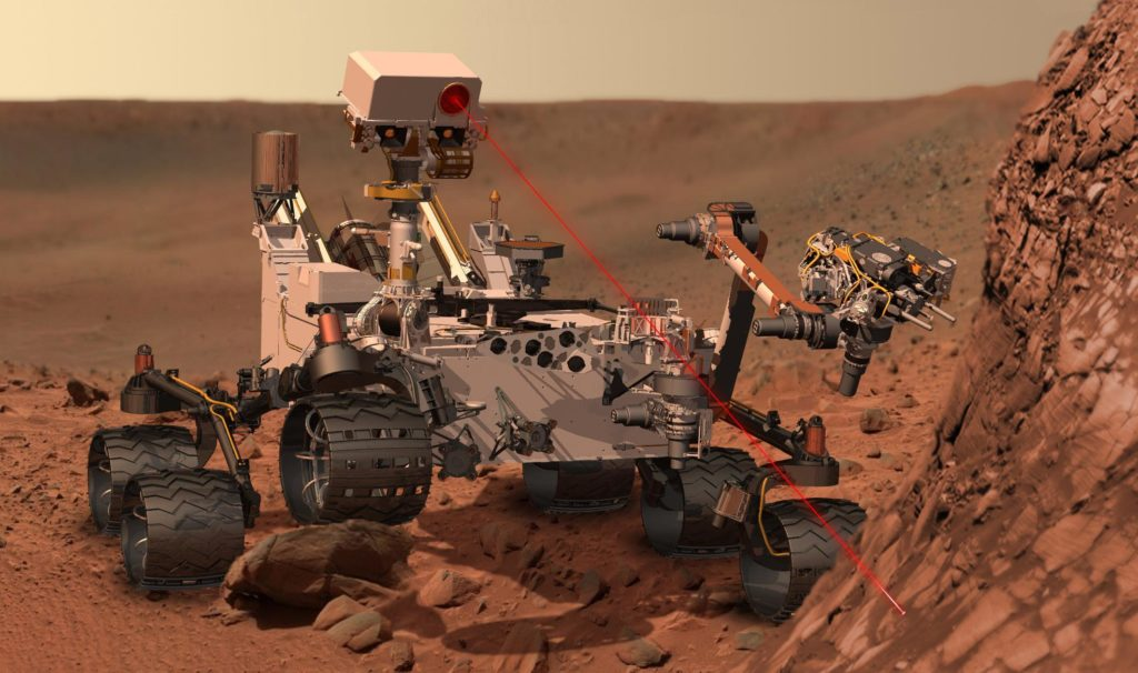Artist's conception of the Curiosity rover vaporizing rock on Mars. The rover landed on Mars in August 2012. Credit: NASA.