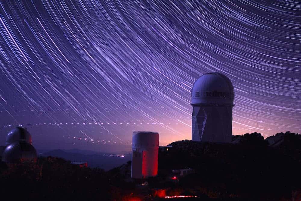 Star trails take shape around the story Mayall Telescop dome in Arizona. P. Marenfeld and NOAO/AURA/NSF).