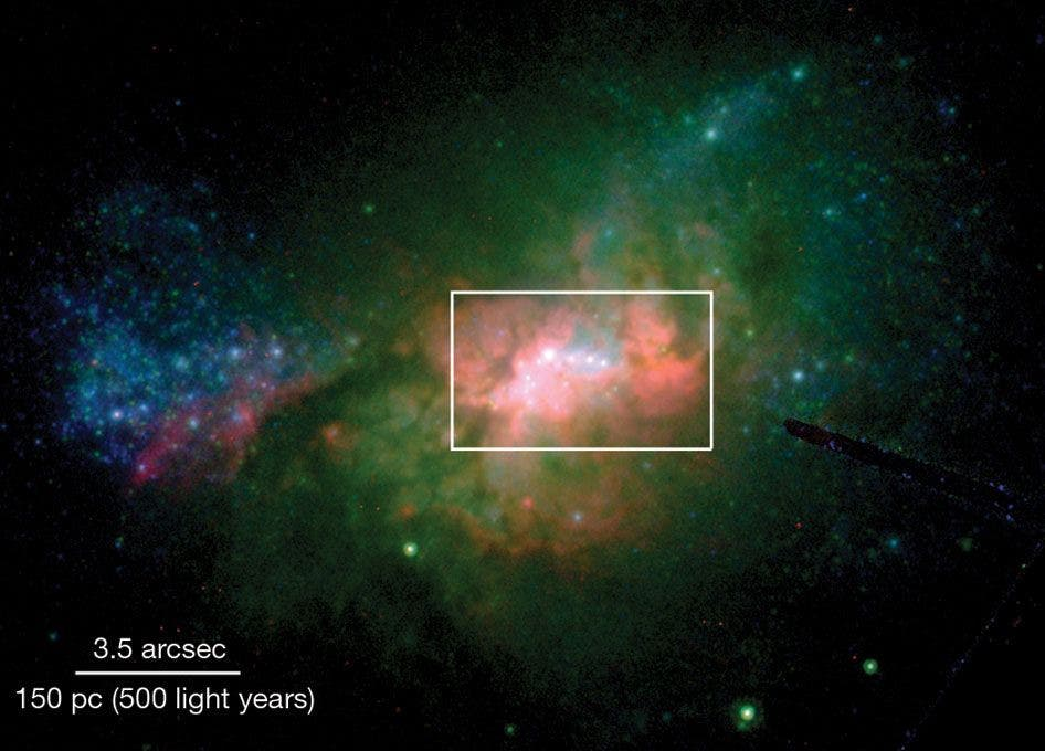 Henize 2–10: a dwarf galaxy that hides a massive secret ( Reines et al. (2011))
