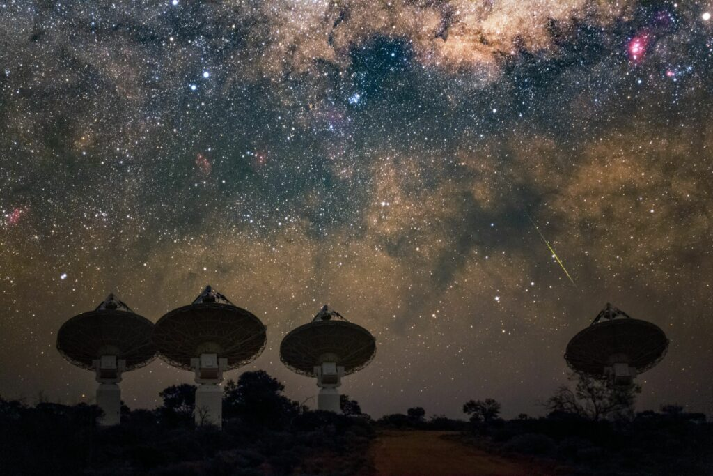Core antennas of CSIRO's ASKAP radio telescope in Western Australia pointing at the Milky Way. (Credit: CSIRO/ Alex Cherney)