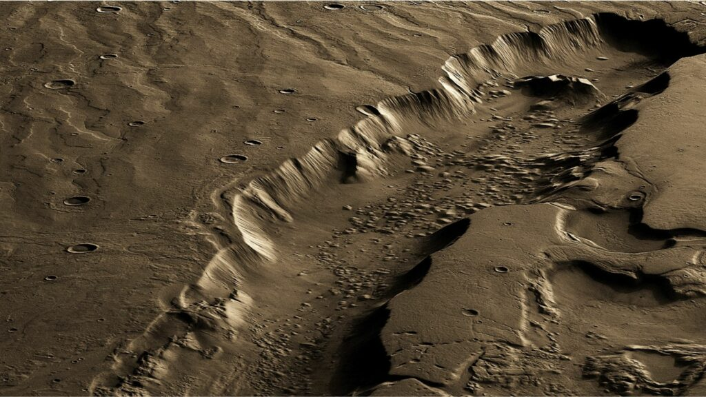 A vertically exaggerated and false-colour perspective of a large, water-carved channel on Mars called Dao Vallis. Whether channels like these on Mars were carved by surface water or groundwater is highly debated. The channel is ~40 km wide, ~2.5 km deep, and more than 500 km in length. (ESA/DLR/FU Berlin, CC BY-SA 3.0 IGO. 3D rendered and coloured by Lujendra Ojha.)